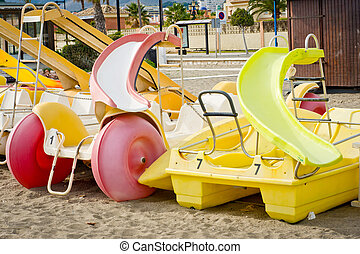 pedal boats in a beach