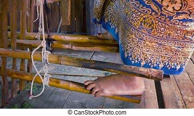 Pedal mechanism of ancient loom. Myanmar - Video 1080p -...