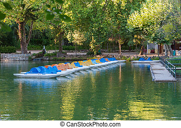Pedalos on a lake in park