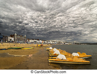 Pedalos on the beach at Weymouth Dorset under dramatic...
