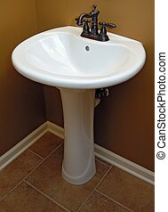 Pedestal sink in a tuscan style bathroom