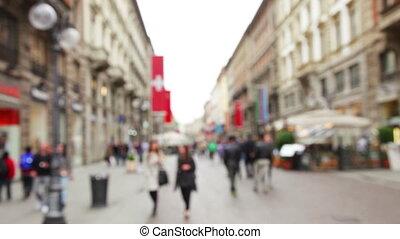 Pedestian traffic through Milan city street - Unfocused...