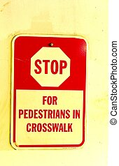 PEDESTRAIN STOP SIGN - A red and yellow pedestrian stop sign