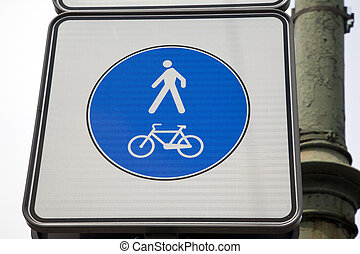 Pedestrian and bicycle sign in urban setting