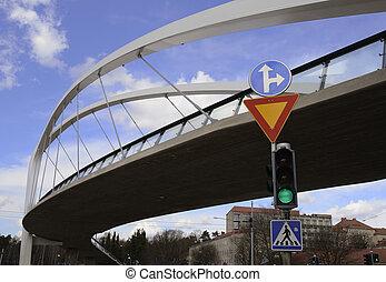 pedestrian bridge and traffic light