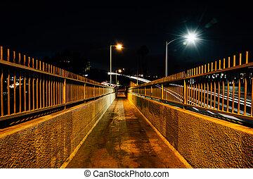 Pedestrian bridge at night, in Ventura, California.