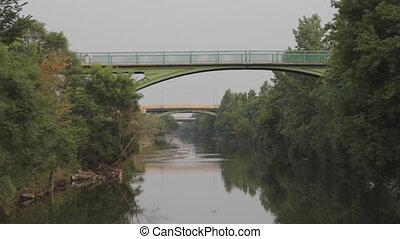 Pedestrian bridge over river.