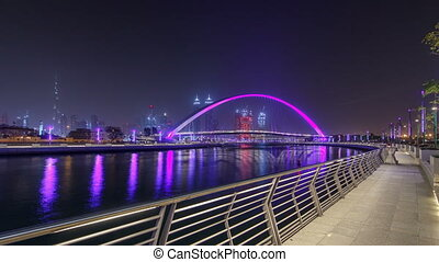 Pedestrian Bridge over the Dubai Water Canal night timelapse hyperlapse, United Arab Emirates