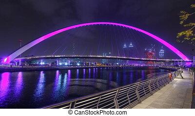 Pedestrian Bridge over the Dubai Water Canal night timelapse, United Arab Emirates