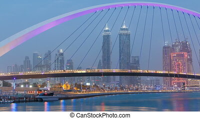 Pedestrian Bridge over the Dubai Water Canal day to night timelapse, United Arab Emirates