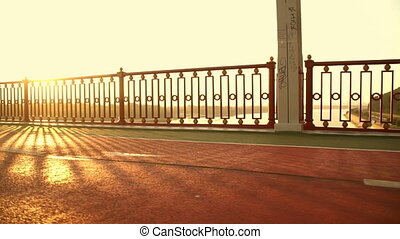 pedestrian bridge over the river - bright sunlit above the...