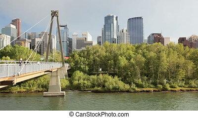 Pedestrian Bridge - Downtown Calgary skyline and pedestrian...