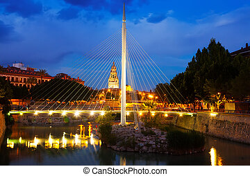pedestrian bridge with Cathedral in night. Murcia, Spain -...