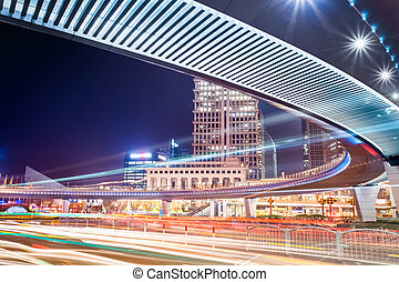 pedestrian bridge with light trails