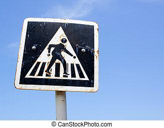 pedestrian cross sign on blue sky