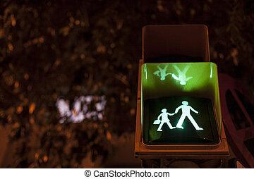 Pedestrian crossing sign light on for schoolchildren