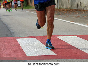 pedestrian crossing with a runner who runs fast during the sport