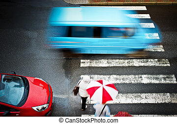 pedestrian crossing with car and people
