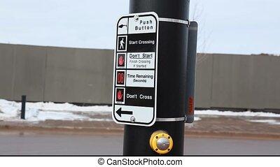 pedestrian crosswalk button to safely cross a busy street