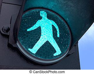 Green light, pedestrians can walk. Image concept of modern life in big cities.