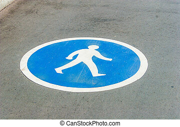 Pedestrian lane sign on asphalt