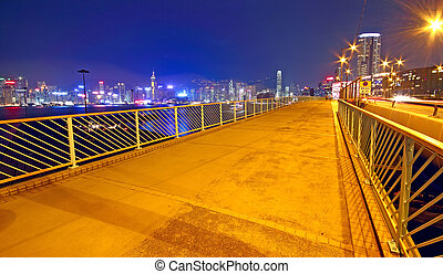 pedestrian overpass and traffic bridge at night