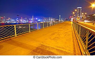 pedestrian overpass and traffic bridge at night