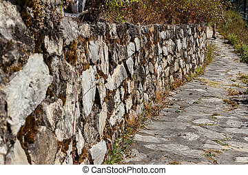 Pedestrian path along the stone wall. Nepal