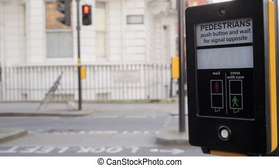 Pedestrian pushes button crossing