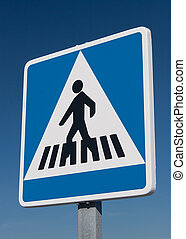Pedestrian road sign against blue sky