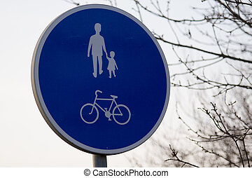 Pedestrian sign - A blue pedestrian or cycling sign in ...