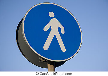 Pedestrian Sign against Blue Sky Background