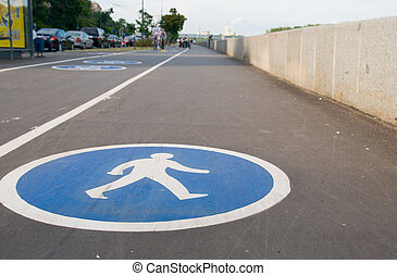 Pedestrian sign on asphalt. Leisure activities