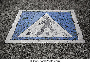 Pedestrian sign on the asphalt