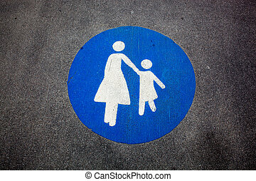 Pedestrian sign painted on a road