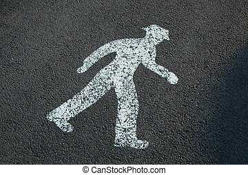 Pedestrian sign painted on the pavement