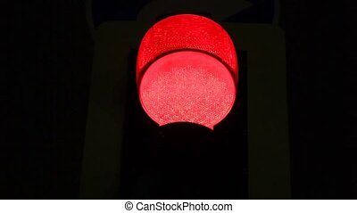 pedestrian traffic light showing red in the night