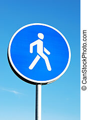 Pedestrian walking road sign