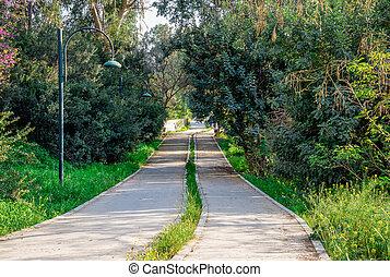 Pedestrian walkway along Pedieos river park in Nicosia,...