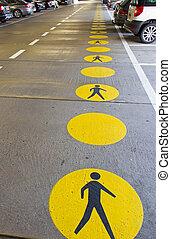 Pedestrian walkway and signage in an parking garage