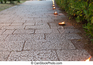 pedestrian walkway decorated with candles