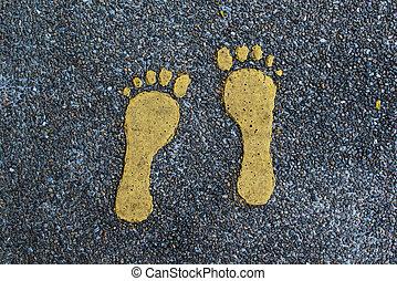 Pedestrian walkway. Footprints painted on asphalt