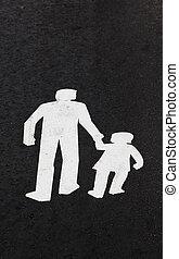 Road markings for a pedestrian walkway painted on the asphalt.