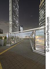 Pedestrain walkway under high rises near Shidome, Tokyo, Japan.