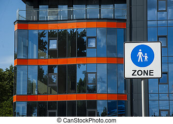 pedestrian zone sign on the background of modern street
