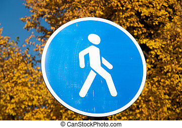 Pedestrian zone sign over autumn trees background