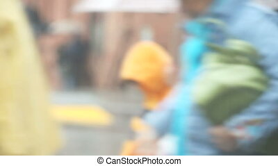 pedestrians close up in heavy rain