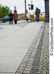 Pedestrians crossing a street of big city - shallow depth of field