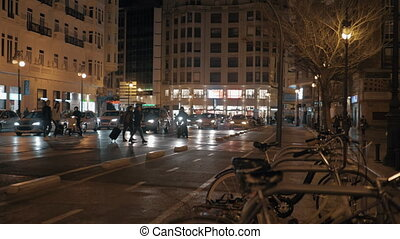 Pedestrians crossing the road in night Valencia, Spain - ...