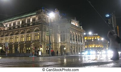 Pedestrians go on pedestrian crossing in front of Viennese opera, time lapse
